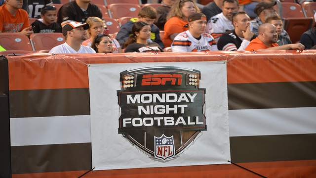 A sign for ESPN Monday Night Football hangs on the end zone wall during an NFL preseason football game between the Cleveland Browns and the Buffalo Bills Thursday, Aug. 20, 2015, in Cleveland. Buffalo won 11-10. (AP Photo/David Richard)