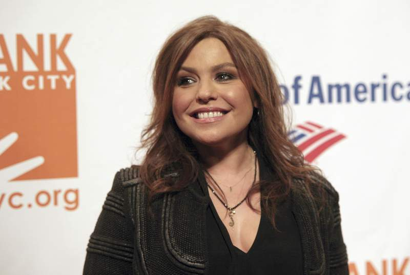 FILE - In this April 9, 2014 file photo, Rachel Ray attends the Food Bank of NYC Can Do Awards Benefit Gala on in New York. Officials said Friday, Aug. 21, 2020, that a fire that tore through celebrity chef Rachel Ray's upstate New York home started in a fireplace chimney. The New York State Office of Fire Prevention and Control said the Aug. 9 fire at the house in Lake Luzerne, N.Y., was accidental. (Photo by Andy Kropa/Invision/AP, File )