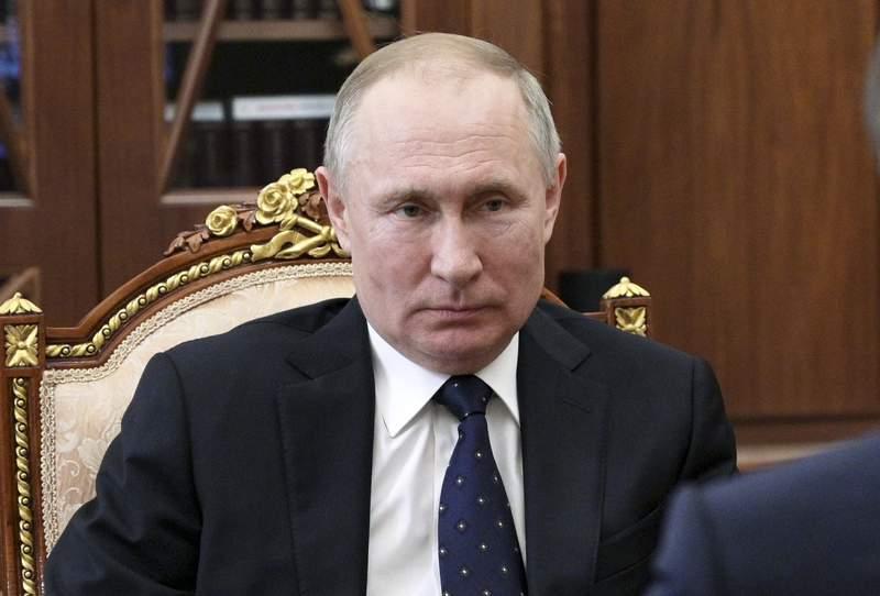 Russian President Vladimir Putin listens to Education Minister Sergei Kravtsov during their meeting in the Kremlin in Moscow, Russia, Thursday, March 12, 2020. (Alexei Druzhinin, Sputnik, Kremlin Pool Photo via AP)