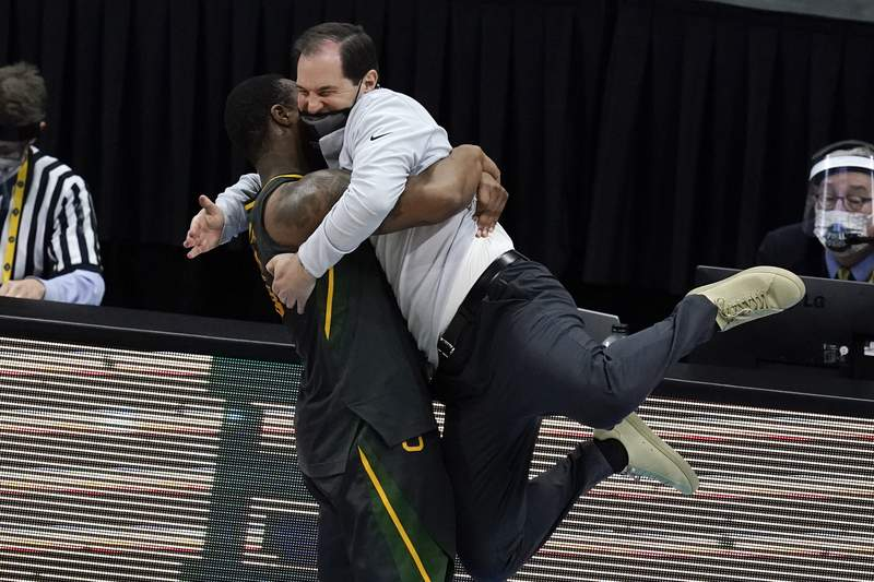 Baylor head coach Scott Drew gets a hug from guard Mark Vital at the end of the championship game against Gonzaga in the men's Final Four NCAA college basketball tournament, Monday, April 5, 2021, at Lucas Oil Stadium in Indianapolis. Baylor won 86-70. (AP Photo/Darron Cummings)