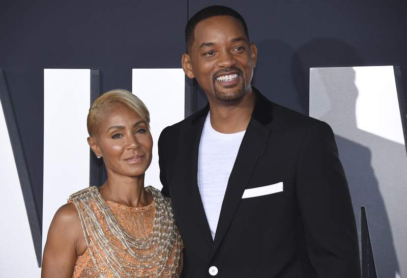 """FILE - In this Oct. 6, 2019 file photo, Jada Pinkett Smith, left, and her husband Will Smith attend the premiere of """"Gemini Man"""" in Los Angeles. Pinkett Smith has admitted to having a relationship with musician August Alsina when she and her husband were separated. In a conversation on her series """"Red Table Talk,"""" she said she was reluctantly discussing Alsina's comments because of the public speculation they provoked. Will Smith appeared on the show to discuss the chapter in their lives. (Photo by Phil McCarten/Invision/AP, File)"""