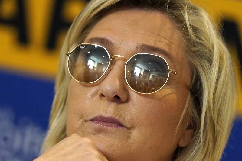 FILE - In this June 17, 2021 file photo, far-right leader Marine le Pen looks on during a press conference in Toulon, southern France. French far-right leader Marine Le Pen is coming under biting criticism from current and former supporters for taking her anti-immigration National Rally too mainstream, with some suggesting the strategy could cost her next year's presidential race. (AP Photo/Daniel Cole, File)