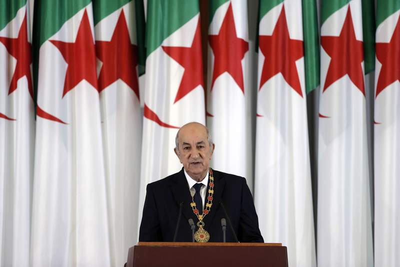 FILE - In this Thursday, Dec. 19, 2019 file photo, Algerian president Abdelmadjid Tebboune delivers a speech during an inauguration ceremony in the presidential palace, in Algiers, Algeria. Tebboune has been transferred to Germany for specialist medical treatment a day after his countrys presidency announced he had been hospitalized but not revealed why. Several senior officials in the 75-year-old presidents entourage developed COVID-19 symptoms on Saturday, Oct. 24, 2020 and the president was placed in what the government called voluntary preventive confinement. (AP Photo/Toufik Doudou, FILE)