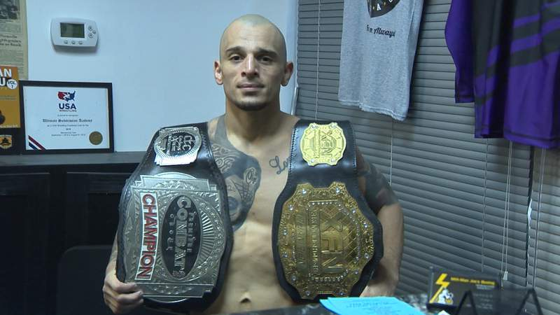 Ray Rodriguez shows off some of his belts as he prepares for his next UFC fight in Las Vegas.