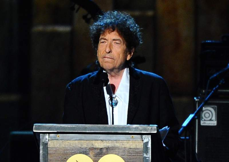 FILE - In this Feb. 6, 2015, file photo, Bob Dylan accepts the 2015 MusiCares Person of the Year award at the 2015 MusiCares Person of the Year show in Los Angeles. Dylan, who has a reputation as a relentless road warrior, has returned to the stage for the first time since things shut down because of the pandemic...at least on film. Dylan gave a 13-song performance Sunday, July 18, 2021, for fans who paid $25 to see him through the live-streaming platform Veeps. (Photo by Vince Bucci/Invision/AP, File)