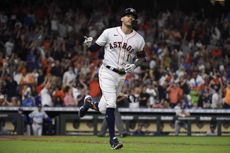 Houston Astros' Carlos Correa rounds the bases after hitting a solo home run during the sixth inning of a baseball game against the Los Angeles Dodgers, Wednesday, May 26, 2021, in Houston. (AP Photo/Eric Christian Smith)