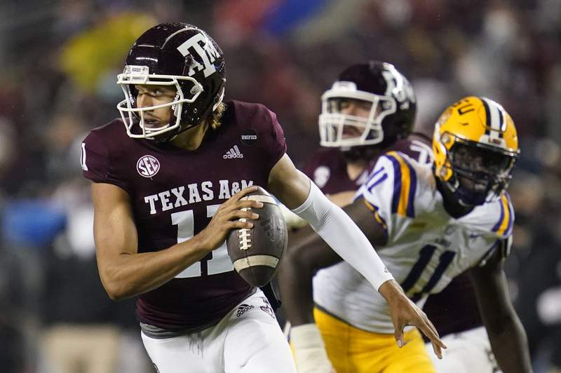 Texas A&M quarterback Kellen Mond (11) is chased out of the pocket by LSU defensive lineman Ali Gaye (11) during the first quarter of an NCAA college football game, Saturday, Nov. 28, 2020. in College Station, Texas.