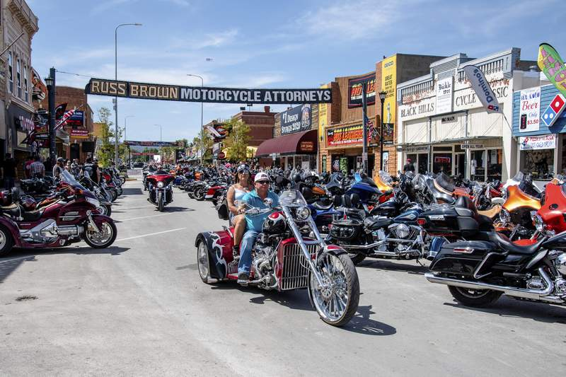 FILE - In this Aug. 15, 2020 file photo, bikers ride down Main Street during the 80th annual Sturgis Motorcycle Rally in Sturgis, S.D.   This summers huge motorcycle rally in South Dakota led to dozens of coronavirus cases in neighboring Minnesota. Thats the finding of a report Friday, Nov. 20,  from the Centers for Disease Control and Prevention. (Amy Harris/Invision/AP)