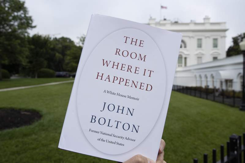 "FILE - In this June 18, 2020, file photo a copy of ""The Room Where It Happened,"" by former national security adviser John Bolton, is photographed at the White House in Washington. Trump administration officials repeatedly exerted political pressure in an unsuccessful effort to block the release of former national security adviser John Boltons tell-all book, a career government records professional said in a court filing Wednesday, Sept. 23. (AP Photo/Alex Brandon, File)"