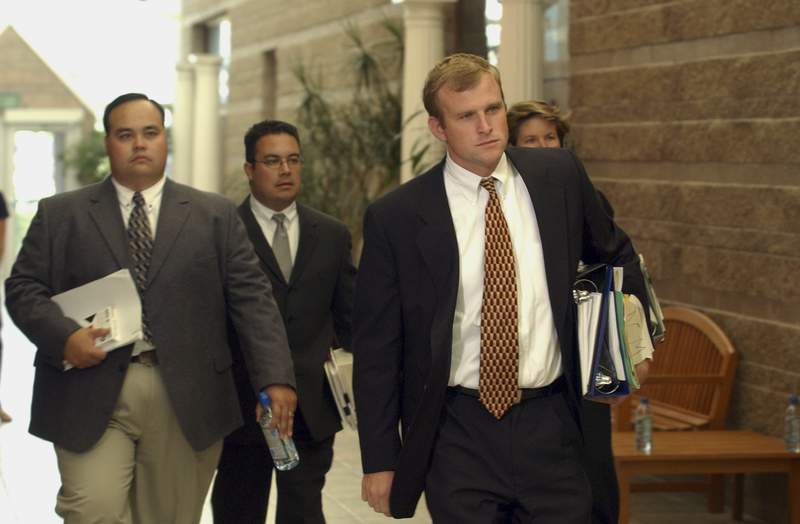 FILE - In this Oct. 9, 2003, file photo, District Attorney Mark Hurlbert, right,  Eagle County Sheriff's Detective Doug Winters, left, and Deputy District Attorney Gregg Crittenden rear, members of the team prosecuting Los Angeles Lakers star Kobe Bryant on sexual assault charges, enter the court for a preliminary hearing  at the Justice Center in Eagle, Colo. Hurlbert said in an interview with The Associated Press he is shocked and saddened by the senseless deaths of Bryant, his daughter Gianna and seven others this week. But he remains confident he would have won a conviction against Bryant in 2003-2004, had the woman who accused Bryant not decided to end the criminal case during jury selection. (AP Photo/Ed Andrieski, Pool, File)