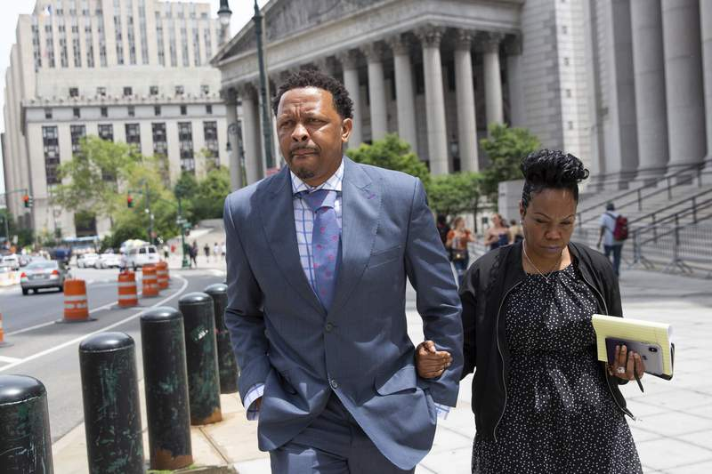 FILE - In this June 7, 2019, file photo, former Oklahoma State assistant basketball coach Lamont Evans leaves Federal Court in New York. An NCAA infractions committee panel announced Friday, June 5 2020,  that former Oklahoma State assistant mens basketball coach Lamont Evans violated ethical-conduct rules by accepting up to $22,000 in bribes from financial advisers. (AP Photo/Kevin Hagen, File)