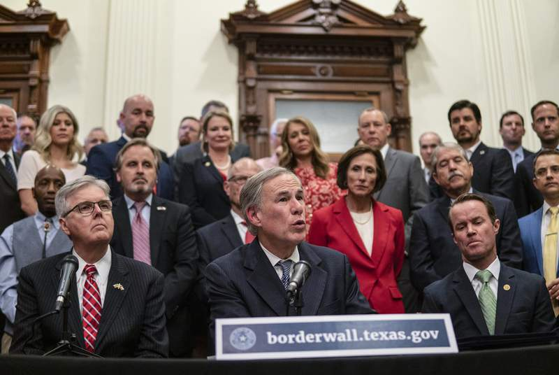 Flanked by Lt. Gov. Dan Patrick and House Speaker Dade Phelan, Gov. Greg Abbott held a press conference at the Capitol to provide more details on his plan for Texas to build its own border wall. June 16, 2021.
