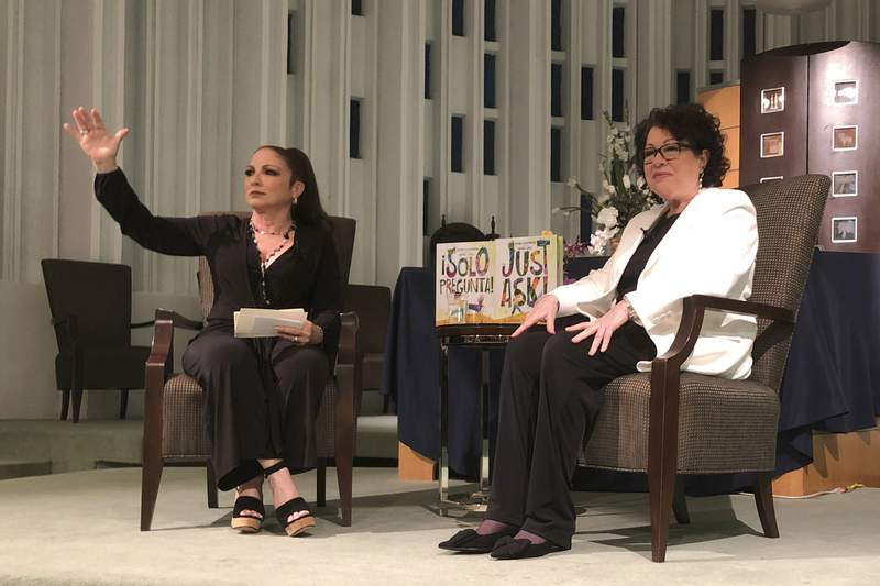 """In this Tuesday, Jan. 28, 2020 photo, Singer Gloria Estefan moderates a presentation with Supreme Court Justice Sonia Sotomayor in Miami. Sotomayor spoke to a crowd about her new book """"Just Ask"""". The new illustrated book teaches children and parents how to be better citizens by explaining that acts of civic participation turn people into heroes. (AP Photo/Adriana Gomez Licon)"""