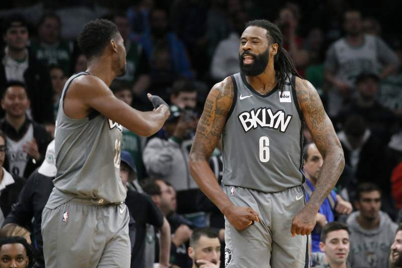 Brooklyn Nets center DeAndre Jordan (6) celebrates with guard Caris LeVert late in overtime of the team's NBA basketball game against the Boston Celtics, Tuesday, March 3, 2020, in Boston. (AP Photo/Mary Schwalm)