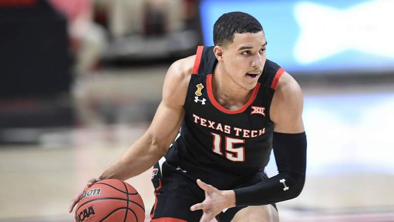 Texas Tech's Kevin McCullar (15) controls the ball during the first half of an NCAA college basketball game against Baylor in Lubbock, Texas, Saturday, Jan. 16, 2021. (AP Photo/Justin Rex)