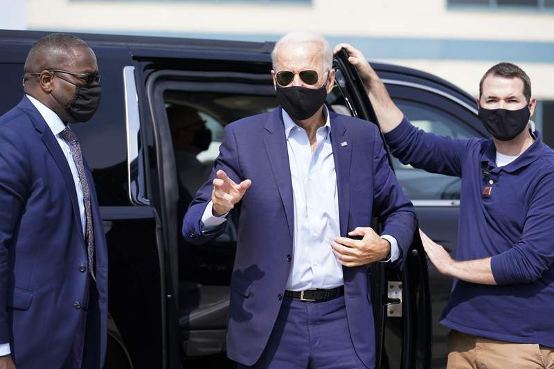 Democratic presidential candidate former Vice President Joe Biden arrives to board a plane at New Castle Airport, in New Castle, Del., Friday, Sept. 18, 2020, en route to Duluth, Minn. (AP Photo/Carolyn Kaster)