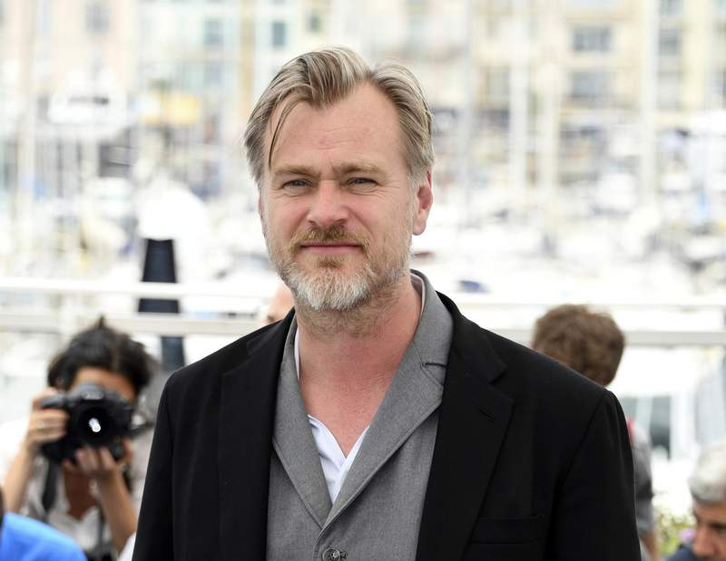 FILE - Director Christopher Nolan poses during a photo call at the 71st international film festival, Cannes, southern France on May 12, 2018. After a public fallout over release strategy with Warner Bros., Nolans next film, about J. Robert Oppenheimer and the development of the atom bomb, will be released by Universal Pictures. (Photo by Arthur Mola/Invision/AP, File)