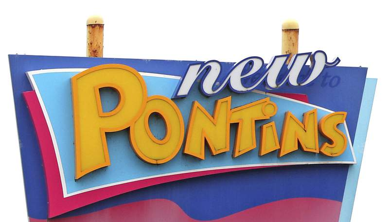 FILE - This Nov. 5, 2020 file photo shows a sign for a Pontins holiday park. A chain of holiday parks in Britain kept an undesirable guests list of Irish surnames in an attempt to keep out members of the Irish Traveller community, the U.K. equalities watchdog said Tuesday March 2, 2021. (Peter Byrne/PA via AP, File)