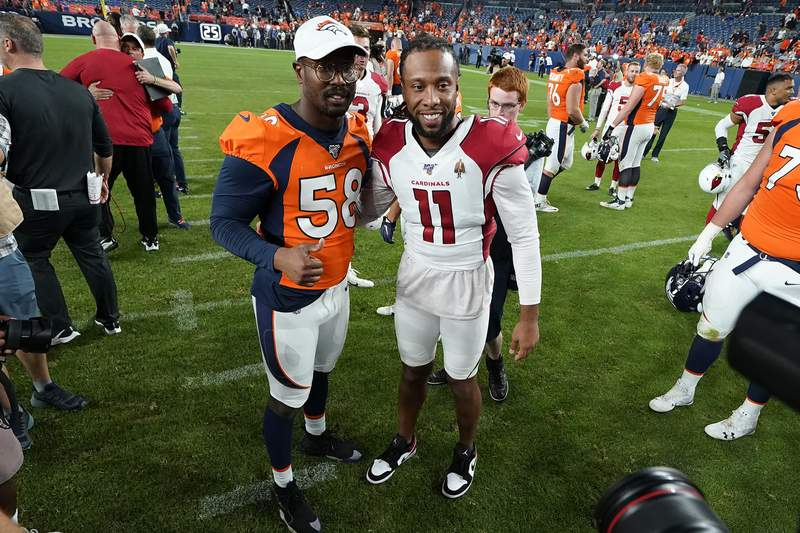 FILE - In this Aug. 29, 2019, file photo, Denver Broncos outside linebacker Von Miller (58) greets Arizona Cardinals wide receiver Larry Fitzgerald (11) after an NFL preseason football game in Denver. The NFL will cut its preseason in half and push back the start of exhibition play so teams have more time to train following an all virtual offseason made necessary by the coronavirus pandemic, a person with knowledge of the decision told The Associated Press. The person spoke on condition of anonymity because the league hasnt announced that the preseason will be cut from four games to two. (AP Photo/Jack Dempsey, File)