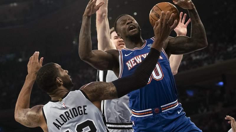 San Antonio Spurs center LaMarcus Aldridge (12) guards New York Knicks forward Julius Randle (30) in the first half of an NBA basketball game, Saturday, Nov. 23, 2019, at Madison Square Garden in New York.