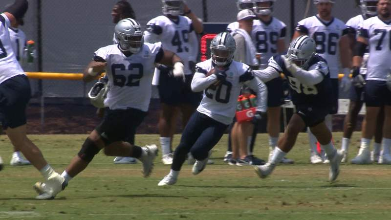 Cowboys running back Tony Pollard catches a pass and turns upfield during practice at training camp in Oxnard, California.
