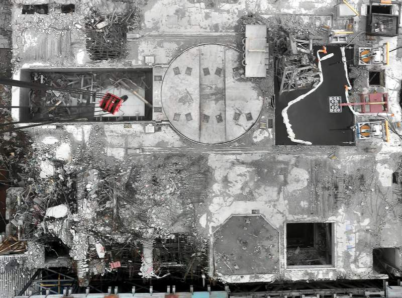This Jan. 31, 2014, image released by Tokyo Electric Power Company Holdings shows the aerial view of the No. 3 reactor, with its roof blown off and shield plug (circle in the middle) exposed, in Okuma town, Fukushima prefecture, northeastern Japan. A draft investigation report into the 2011 Fukushima nuclear meltdown, adopted by Japanese nuclear regulators Wednesday, Jan. 27, 2021, says it has detected dangerously high levels of radioactive contamination at two of the three reactors, adding to concerns about decommissioning challenges.(Tokyo Electric Power Company Holdings via AP)