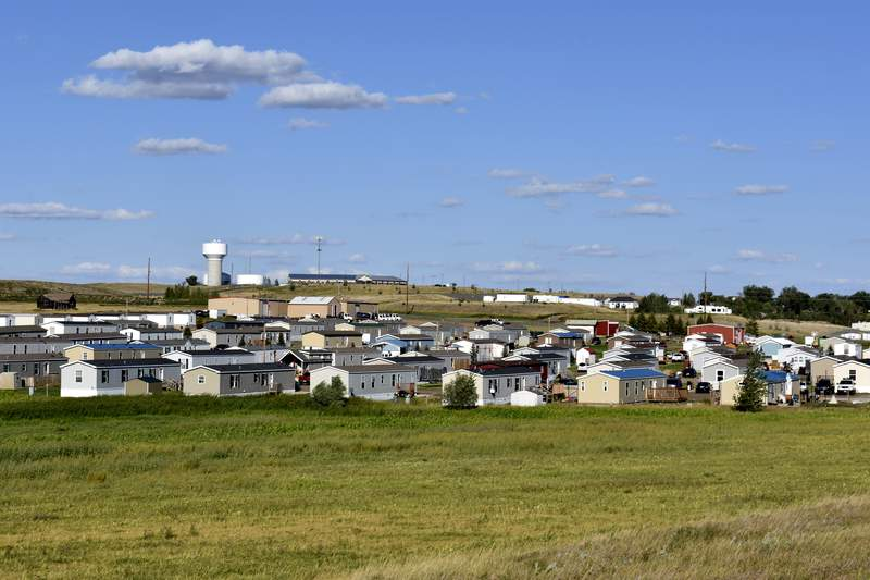 A housing development sits in Aug. 24, 2021, in Watford City, N.D., part of McKenzie County, the fastest-growing county in the U.S. That's according to new figures from the Census Bureau. (AP Photo/Matthew Brown)