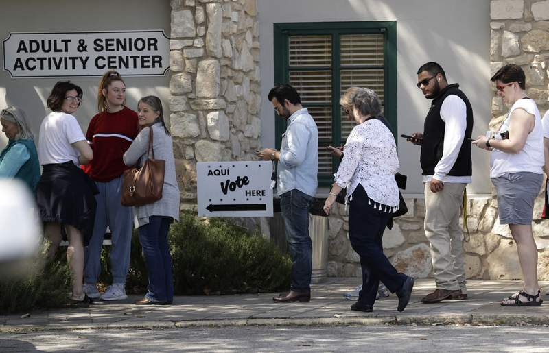 In this Friday, Feb. 28, 2020 photo, voters wait in line at an early polling site in San Antonio. (AP Photo/Eric Gay)