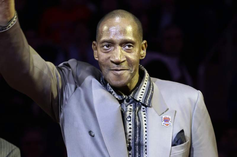 FILE - In this April 5, 2013, file photo, Harthorne Wingo waves to the crowd during a ceremony to honor the 1972-73 world champion New York Knicks NBA basketball team at New York's Madison Square Garden. The former New York Knick and fan favorite Harthorne Wingo has died. His death in a New York City hospital on Jan. 13 was confirmed by the coroner's office. No cause was given. (AP Photo/Frank Franklin II, File)
