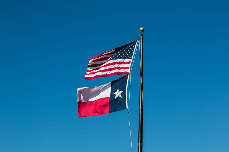 The American flag and the state of Texas flag.