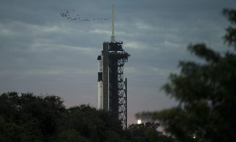 A SpaceX Falcon 9 rocket with the company's Crew Dragon spacecraft onboard is seen on the launch pad at Launch Complex 39A as preparations continue for the Crew-1 mission, Sunday, Nov. 15, 2020, at NASA's Kennedy Space Center in Cape Canaveral, Florida. (Joel Kowsky/NASA via AP)