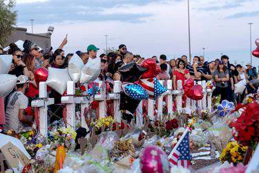 Hundreds mourned the El Paso Walmart shooting victims and their families last year. A new district attorney must weigh whether to prosecute the suspected shooter, whom federal officials also plan to take to trial. (Nick Oza/USA Today Network via REUTERS)