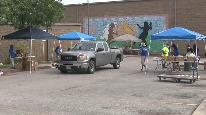 The staff at the Boys and Girls Clubs distributed the donated produce and prepackaged meals for children to needy families Wednesday on the West Side.