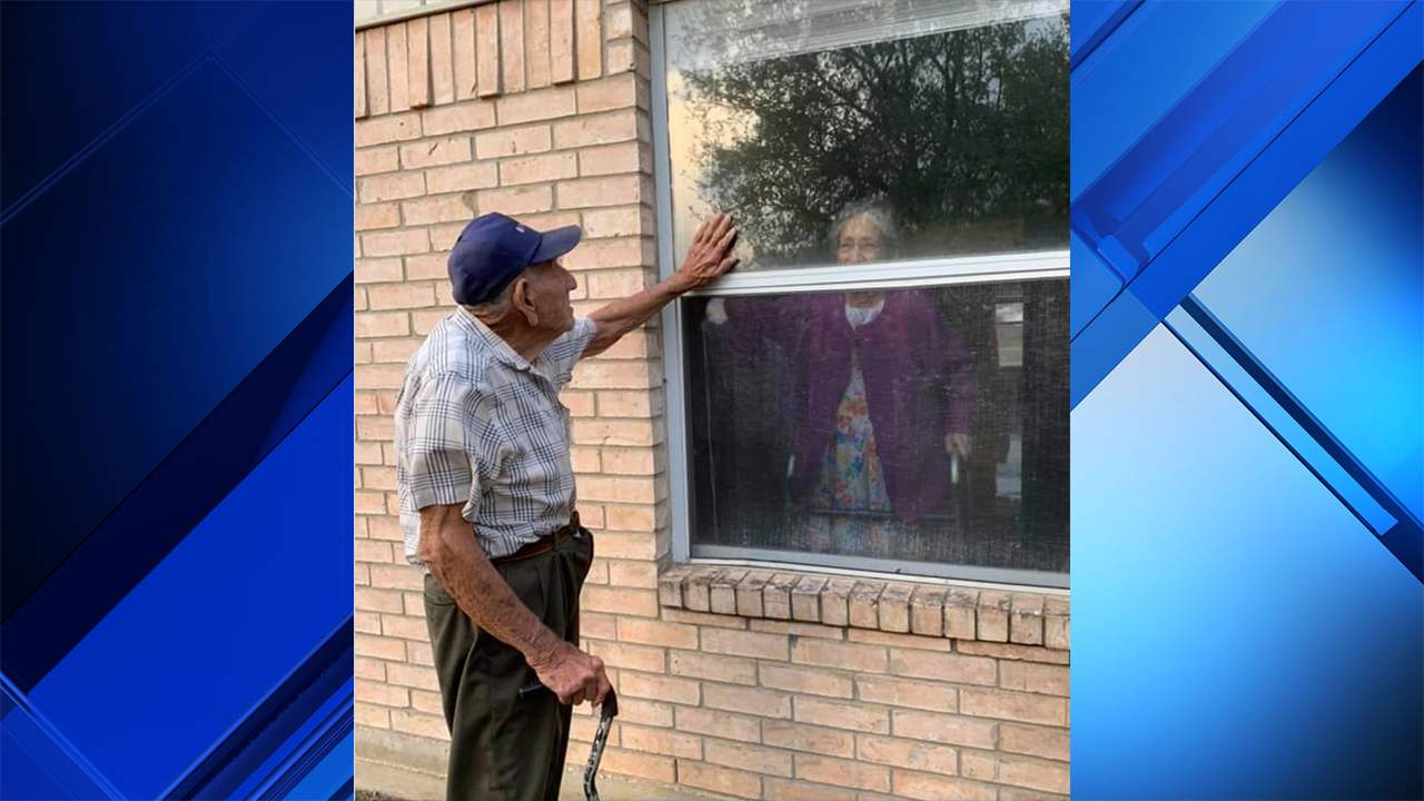 Jimmy Gonzales visits wife through nursing home window.