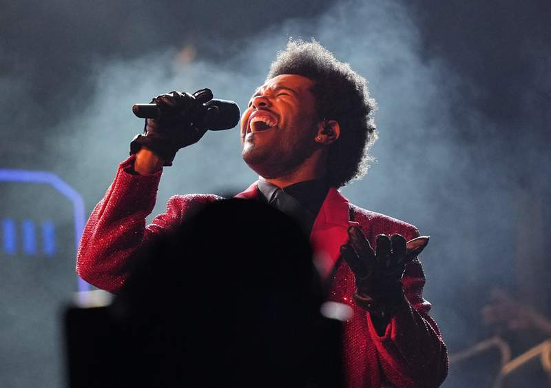 FILE - The Weeknd performs during the halftime show of the NFL Super Bowl 55 football game on Feb. 7, 2021, in Tampa, Fla. The Weeknd, BTS and Billie Eilish will participate in Global Citizen Live, a 24-hour event on Sept. 21 organized to raise funding and awareness to battle worldwide issues including COVID-19, climate change and extreme poverty. (AP Photo/David J. Phillip, File)