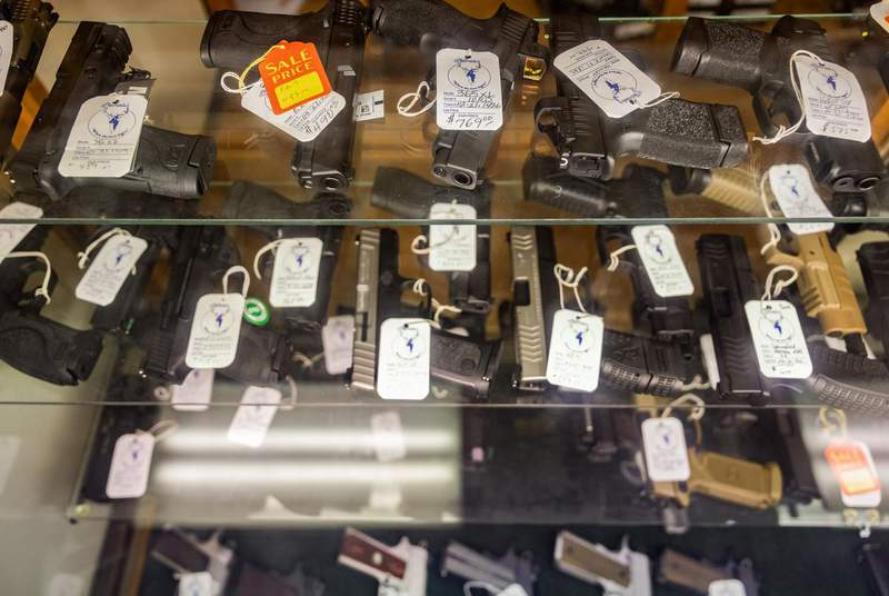 Hundreds of handguns and rifles for sale at McBride's Gun's in Central Austin this month. (Credit: Jordan Vonderhaar for The Texas Tribune)