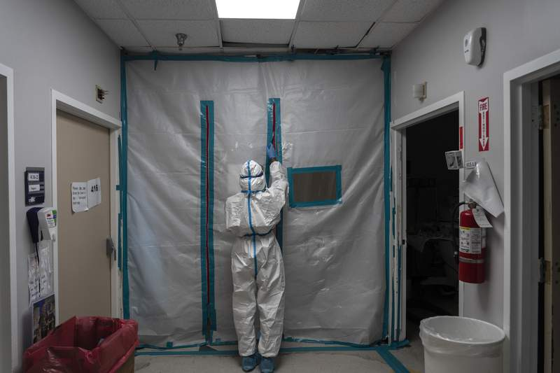 A medical staff exits the COVID-19 intensive care unit (ICU) on New Year's Day at the United Memorial Medical Center on January 1, 2021 in Houston, Texas. (Photo by Go Nakamura/Getty Images)