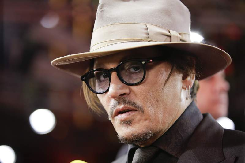 FILE - In this Friday, Feb. 21, 2020 file photo, actor Johnny Depp arrives for the screening of the film Minamata during the 70th International Film Festival Berlin, Berlinale in Berlin, Germany. A British judge on Thursday July 2, 2020, rejected an attempt by tabloid newspaper The Sun to quash a libel suit from Johnny Depp over an article claiming he abused ex-wife Amber Heard. (AP Photo/Markus Schreiber, File)