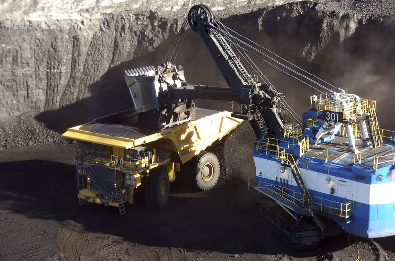 FILE - In this Nov. 15, 2016, file photo, a mechanized shovel loads coal from an 80-feet thick seam at the Spring Creek mine near Decker, Mont. Montana regulators reached a deal Thursday, March 12, 2020, allowing the state to enforce environmental laws at the mine after it was bought last year by a Navajo-owned company. (AP Photo/Matthew Brown, File)