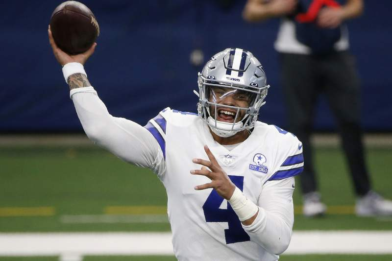FILE - In this Oct. 11, 2020, file photo, Dallas Cowboys quarterback Dak Prescott throws a pass in the first half of an NFL football game against the New York Giants in Arlington, Texas. The NFL is returning to London in October and Tom Brady begins his pursuit of an eighth Super Bowl title against Dak Prescott and the Dallas Cowboys when Tampa Bay hosts the leagues annual kickoff game on Sept. 9. (AP Photo/Michael Ainsworth, File)