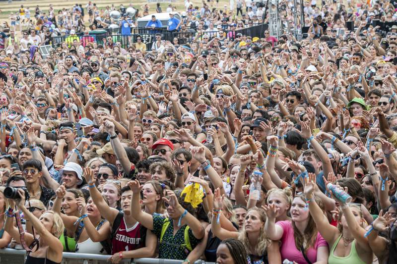 Festival goers are seen on day one of the Lollapalooza Music Festival on Thursday, July 29, 2021, at Grant Park in Chicago. (Photo by Amy Harris/Invision/AP)