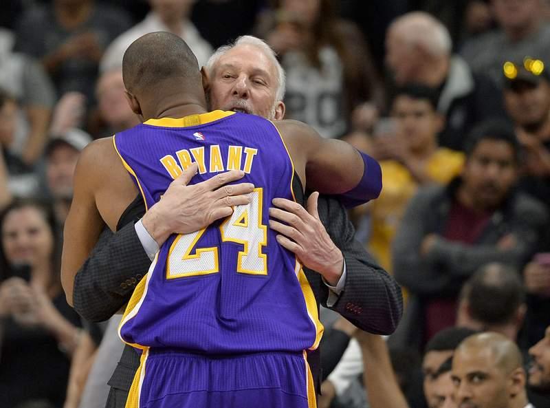 Los Angeles Lakers guard Kobe Bryant (24) hugs San Antonio Spurs head coach Gregg Popovich before an NBA basketball game, Saturday, Feb. 6, 2016, in San Antonio. (AP Photo/Darren Abate)