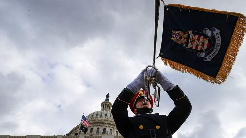 """A member of the U.S. Army Band """"Pershing's Own"""" plays during the inauguration of U.S. President-elect Joe Biden on the West Front of the U.S. Capitol on January 20, 2021 in Washington, DC. During today's inauguration ceremony Joe Biden becomes the 46th president of the United States."""