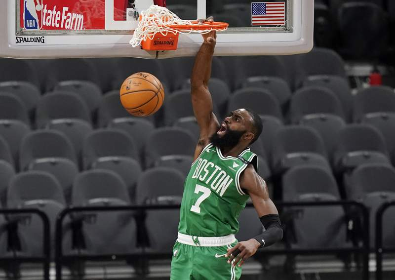 Boston Celtics guard Jaylen Brown (7) scores against the San Antonio Spurs during the second half of an NBA basketball game in San Antonio, Wednesday, Jan. 27, 2021. (AP Photo/Eric Gay)