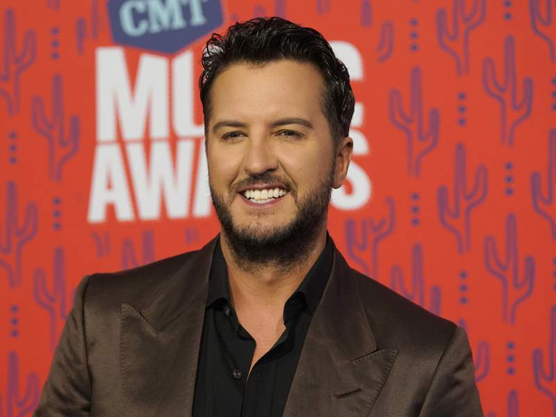 FILE - In this June 5, 2019 file photo, Luke Bryan arrives at the CMT Music Awards at the Bridgestone Arena in Nashville, Tenn. Paula Abdul is set to return as a guest judge on Monday night's first live episode of American Idol replacing Luke Bryan, who announced he tested positive for COVID-19. (AP Photo/Sanford Myers, File)