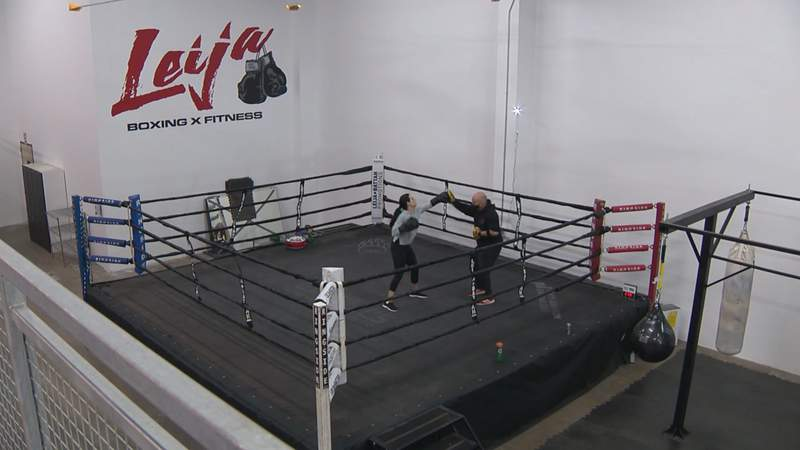 """""""Jesse"""" James Leija works with a client at his new gym on Broadway."""
