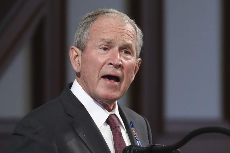 FILE - In this July 30, 2020 file photo, former President George W. Bush speaks during the funeral service for the late Rep. John Lewis, D-Ga., at Ebenezer Baptist Church in Atlanta. (Alyssa Pointer/Atlanta Journal-Constitution via AP, Pool)