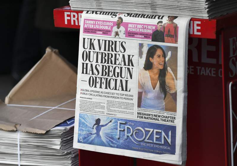 FILE - In this Friday, March 6, 2020 file photo, the front page of the Evening Standard is displayed at Bond Street Station, in London. A U.K. parliamentary report has concluded that Britain's Conservative government waited too long to impose a lockdown early in the COVID-19 pandemic. The report Tuesday, Oct. 12, 2021 says that caused the nation to miss a chance to contain the disease and led to thousands of unnecessary COVID-19 deaths. (AP Photo/Alberto Pezzali, file)