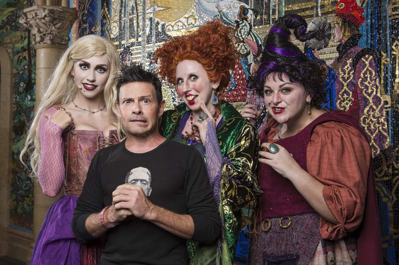 """In this handout photo provided by Disney Parks, Actor Jason Marsden, who voiced the cat Thackery Binx in Disney's """"Hocus Pocus,"""" visits the infamous """"Sanderson Sisters"""" on Sept. 7, 2017, after their live performance at Magic Kingdom Park."""