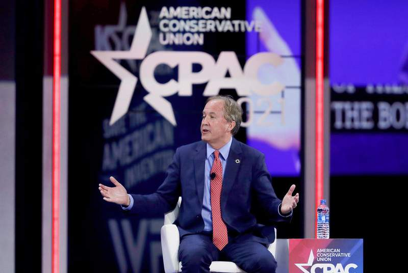 Attorney General Ken Paxton is shown speaking at the Conservative Political Action Conference in Orlando, Florida, on Feb. 27. Several news organizations in Texas have requested copies of the attorney general's work-related communications. (Credit: REUTERS/Joe Skipper)